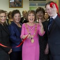 Catherine Clancy cuts the ribbon to the new office