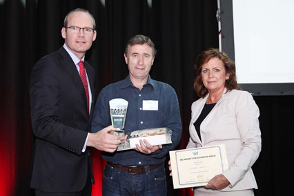 Minister Simon Coveney and Margaret Shine, MD, SRL Consultancy presenting the award to Tom Fehily